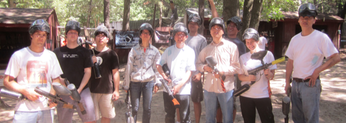 A friendly game of paintball during a lab outing.
